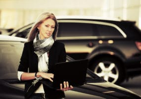 business woman with new car from Sydney Wide Car Brokers